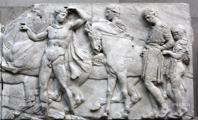 Detail from the Parthenon Frieze. Greek marble sculpture, made between 443-438 BC. The full frieze shows a narrative procession of men, women  horses.