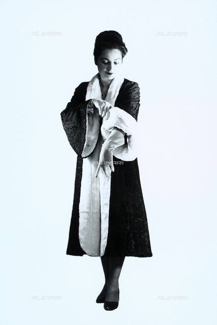 Woman in elegant top-coat