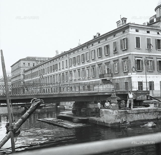 The canal and a stage in the demolition of Verde Bridge in Trieste