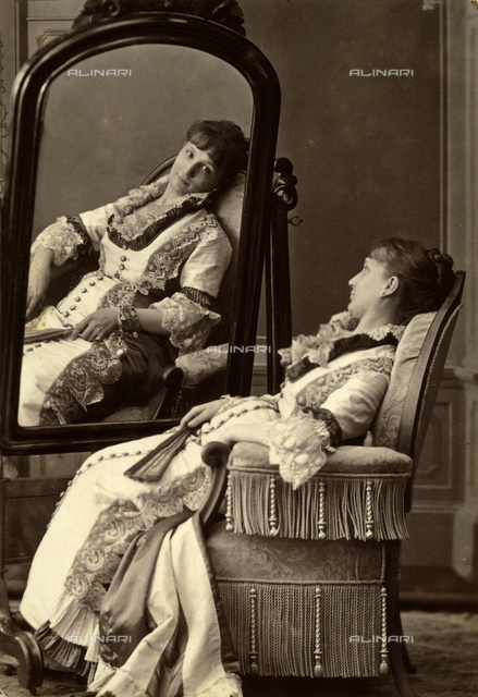 Young woman sitting in front of a mirror