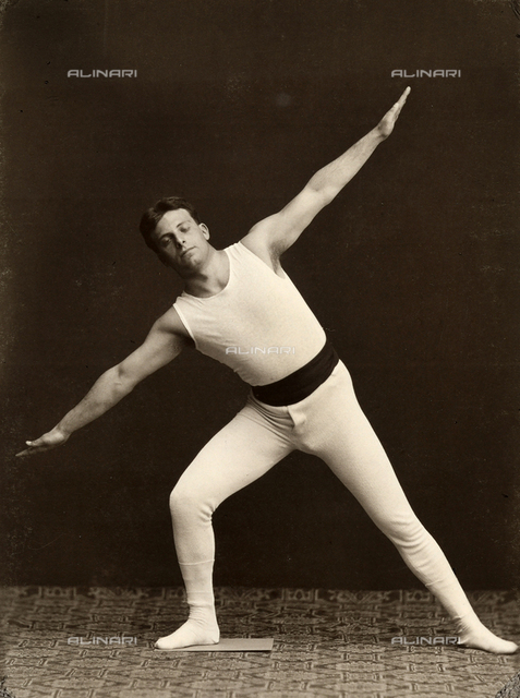 Portrait of a gymnast as he performs an exercise