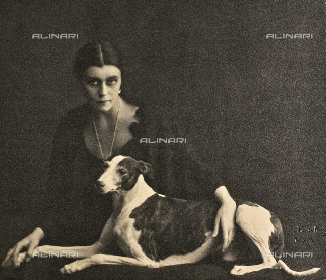 Portrait of a young woman with a greyhound