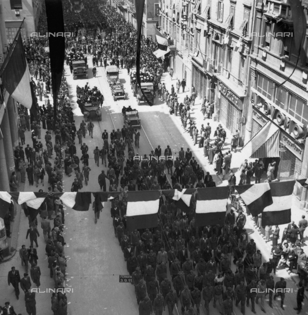 End of the yugoslav demonstration with italian crowd booing in the background in Trieste