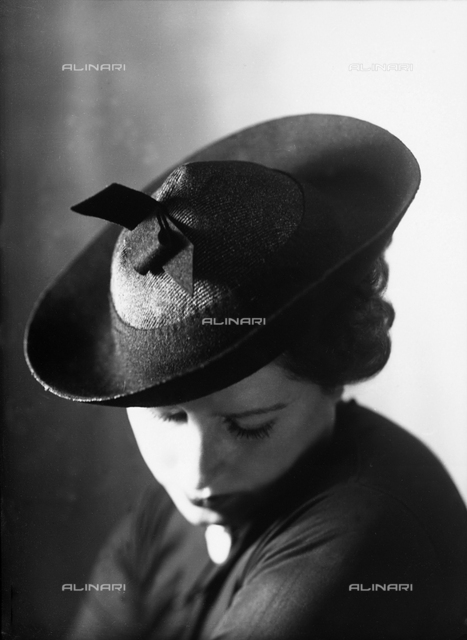 Closeup of a woman with a small hat