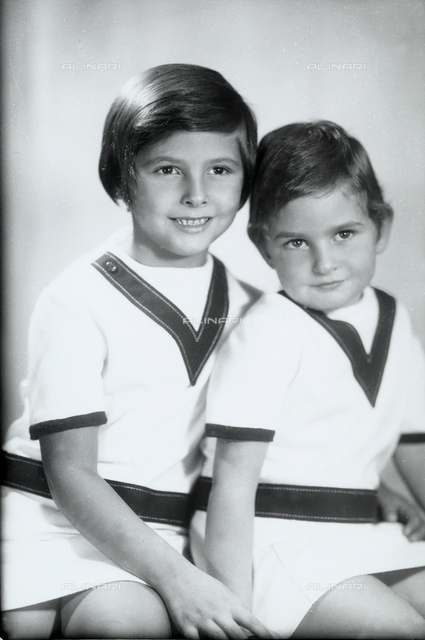 Two little sisters wearing nautical clothing