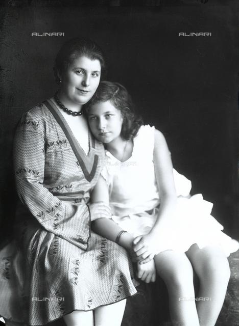Girl embracing a woman