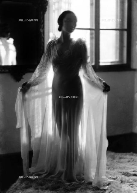 Mrs. Blasig in a night gown