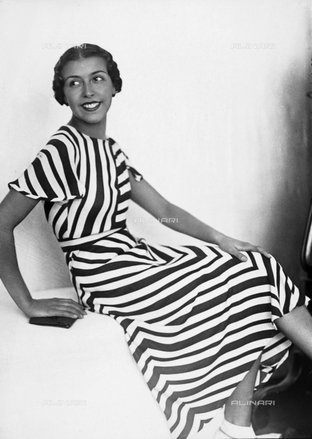 Portrait of a young woman in a striped dress