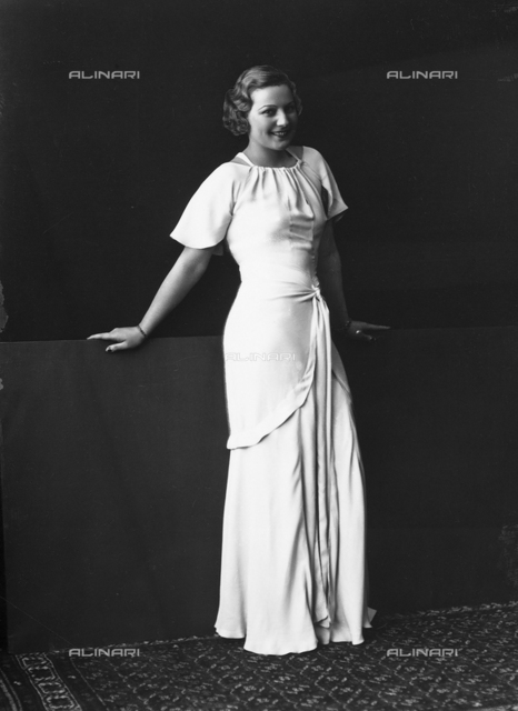Portrait of a woman in a white evening dress