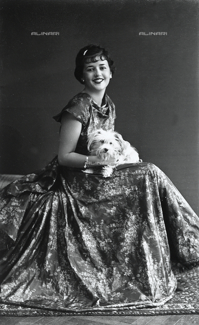 Young woman in a long dress with her dog