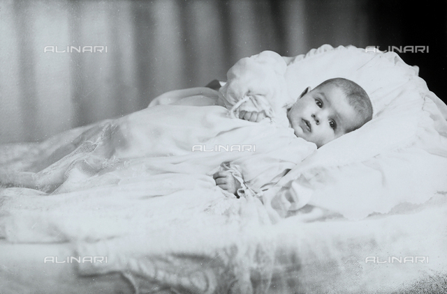 Portrait of a baby in a crib