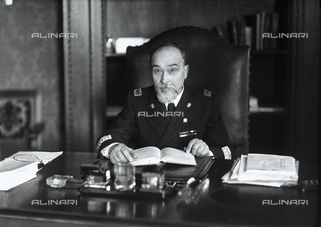 Portrait of a judge sitting at the desk in his study