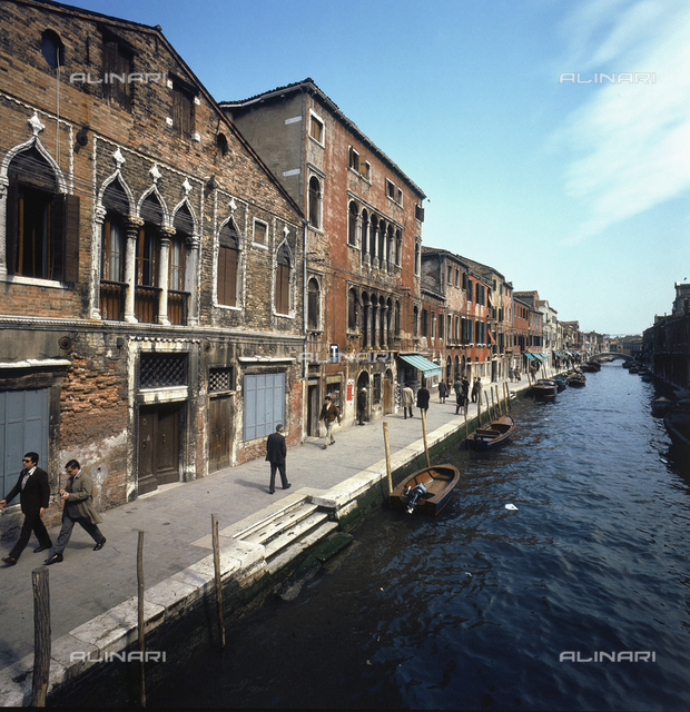 The main canal of Murano, with old buildings and shops lining the banks